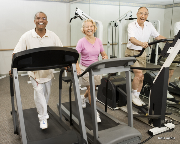 Elderly people working out in gym