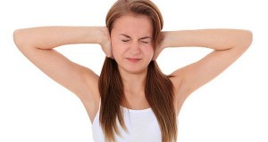 lady suffering from Tinnitus
