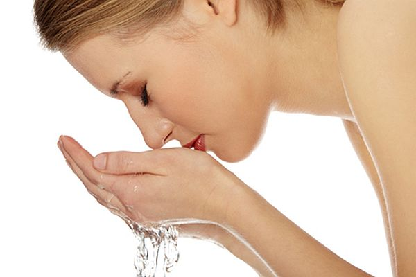 Young female washing her face