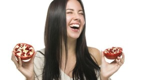 happy laughing girl with fruit to their hands