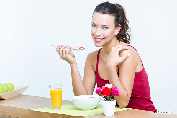 Young woman taking a breakfast cereal at home