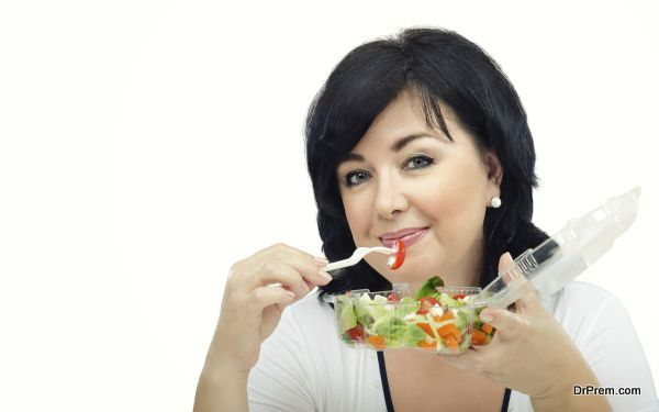 Portrait of woman with takeaway salad