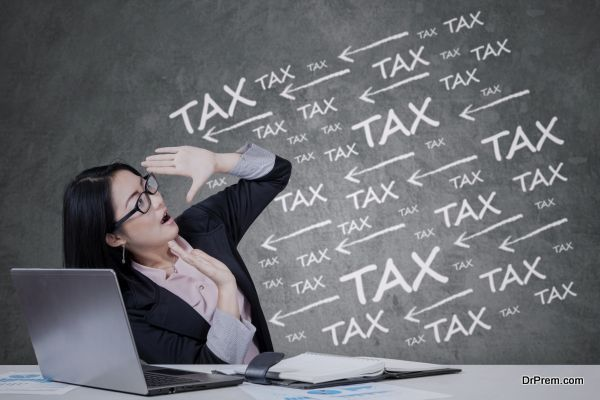 Worried chinese businesswoman working with laptop computer, get tax pressure