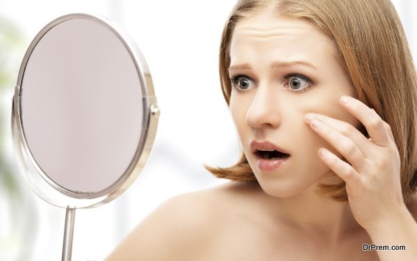 beautiful healthy woman saw in the mirror acne and wrinkles