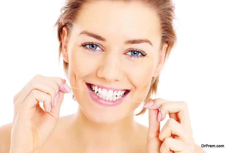 woman-flossing-teeth