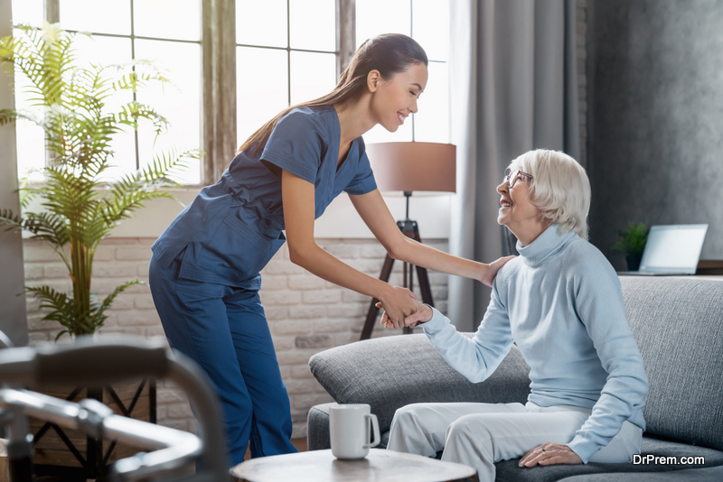 care worker taking care of old woman