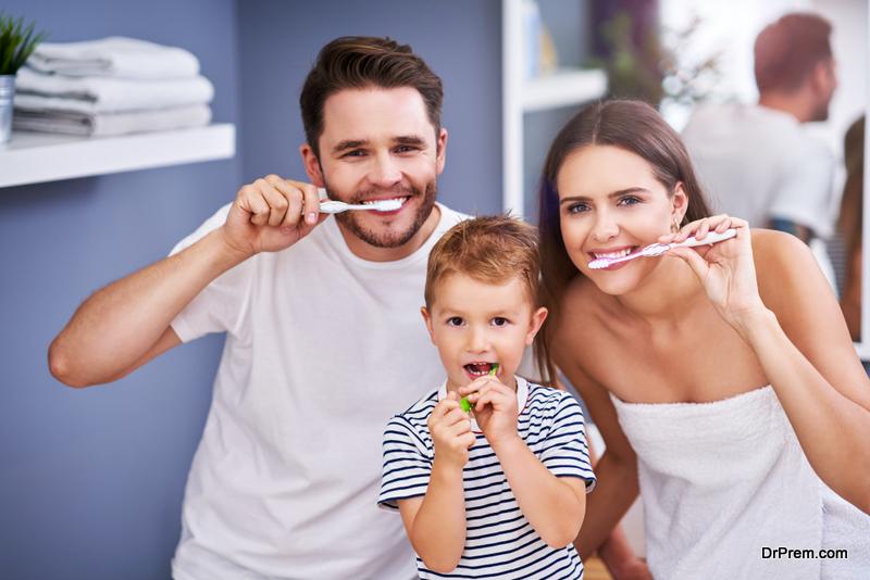 family members brushing teeth