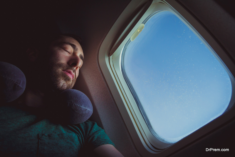 man Sleeping on the Plane
