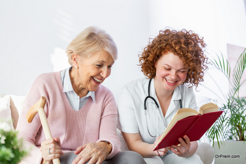 nurse sitting with old woman